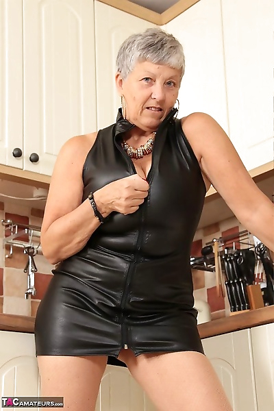 Horny oma pulls down her..
