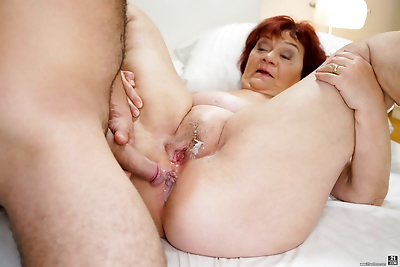Thick older redhead and her..