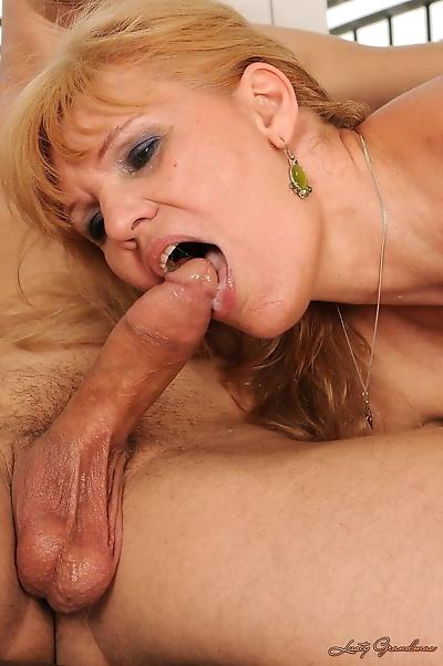 Foxy blonde granny enjoying..