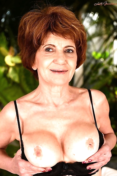 Busty granny in stockings..