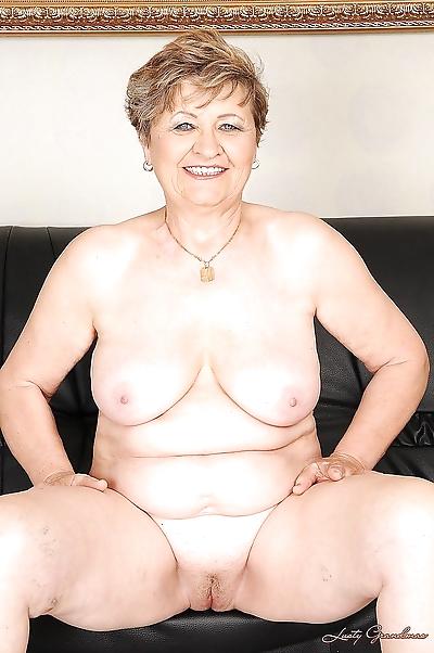 Busty granny on high heels..
