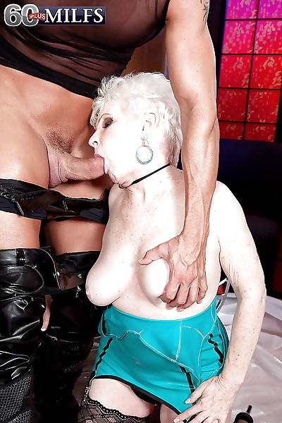 Latex clad granny with saggy..