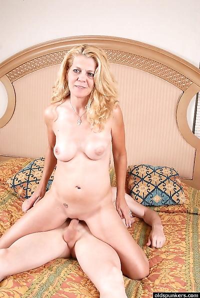 Blonde granny Lori rides..