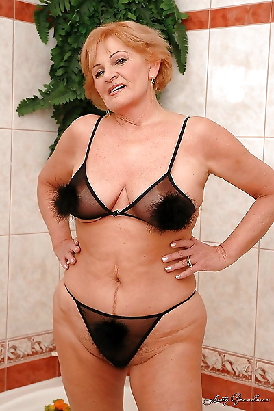 Horny granny with huge boobs..