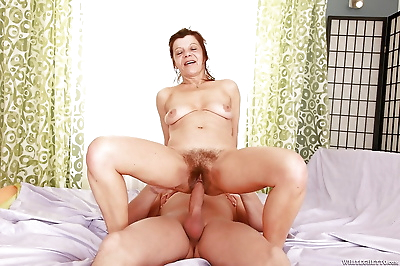 Horny granny gets her hairy..