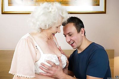 Lusty grandma takes a..