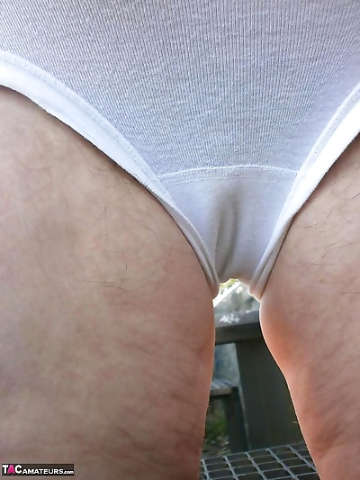 Horny old Caro outdoors in..