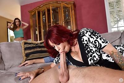 Mature redhead Alyssa Lynn..