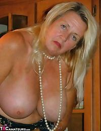 Fat grandmother with blonde hair exposes herself in tan nylons and garters
