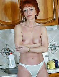 Redheaded housewife ann strips off and spreads - part 4393