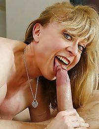 Foxy mom has some dirty fun with a youger lad and gets jizzed over her boobs