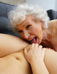Old woman and a young girl kiss after a pussy licking session is complete