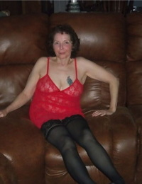 Curly haired mature woman likes sending her younger partner provocative photos