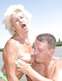 Busty granny with unshaved pussy fucks a youngster outdoor