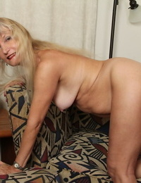 Blonde granny Lisa Cognee demonstrates her hairy pussy in close up