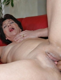 Lustful mature babe sucks and fucks a big black cock in the office