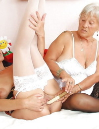 Older lesbian moms in stockings use whip and toys as masturbation aids