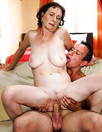Horny granny Pixie strips to ride cowgirl & sucks younger cock for cum facial